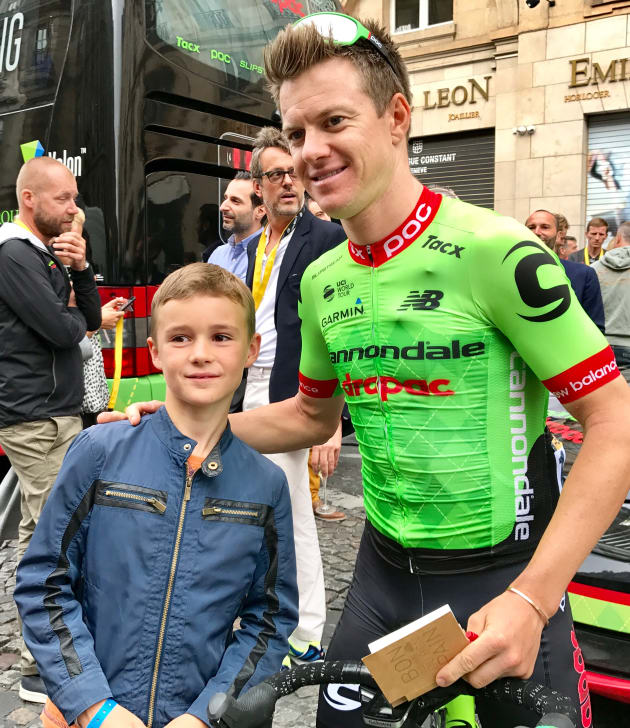 Simon Clarke with a young fan after the finish of the 2017 Tour de France in Paris. Image: Nat Bromhead.