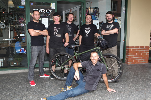 From left to right: Alex Zidarevich of Surly with Donald Graham, Adam Hogan and Maisey from Cheeky Transport, John Fleck from Surly and reclining in front, Stuart Voysey of SCV. Their all standing outside the Cheeky Transport store in Newtown, in Sydney's inner south. The bike is a Surly Ogre, which is displaying two 'bike packing' style of bags that make for more agile handling than traditional panniers.