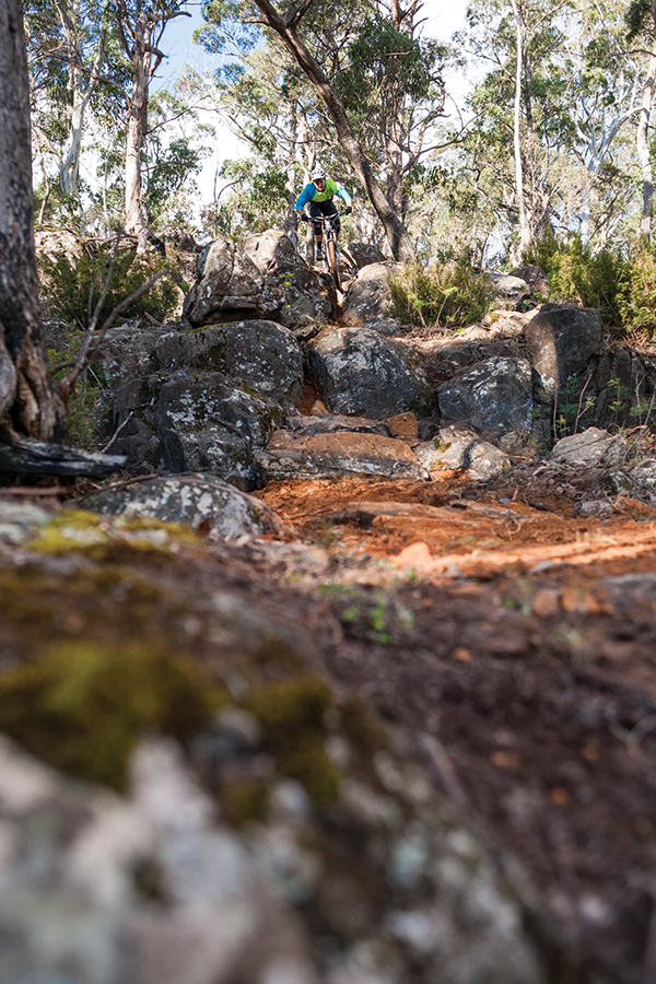 Trail builder Kozi tackles the rocks of Reverb - an optional track near the Juggernaut.