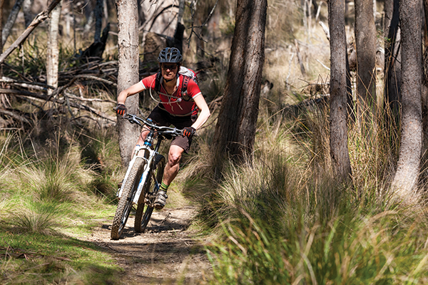 Nick Learmonth pursues her story on the Hollybank singletrack.