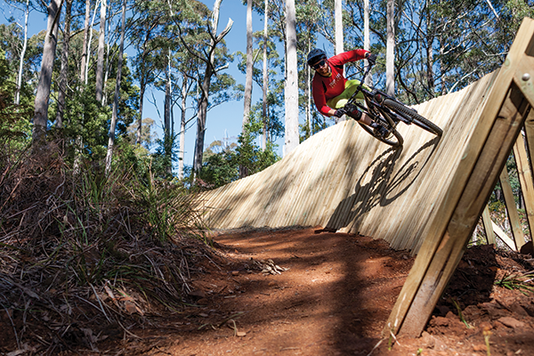Rob Potter on 'No Sweat'. This is an easy 'green' rated trail but this optional wall ride lets you spice things up if you want.