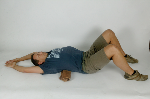 Okay, dropping to the ground underneath your desk may not be viable at the office, but this is a nice passive stretch that shouldn't be too much of an imposition before bed. It is hard to get your head on top of your shoulders, and keep your shoulders back, unless you have good mid-back mobility. This stretch should be a pleasure after a long day tapping the keys (and also after a long day in the saddle for those lucky enough to get out!)