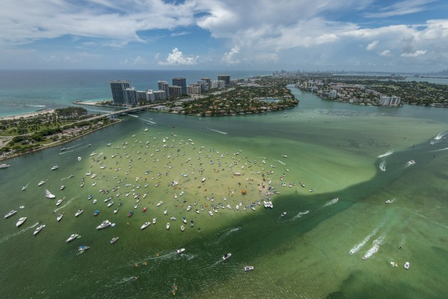 Aerial images work well to provide a sense of place and set the scene for a photographic essay. In this image, hundreds of party-goers flock to the Haulover Sandbar on the Intracoastal Waterway north of Miami. The aerial perspective helped to show the density of boaters that use the area.