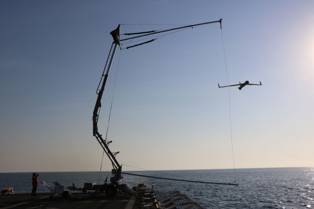A US Coast Guard vessel prepares to recover a Insitu Pacific ScanEagle. Credit: Boeing