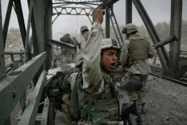 © Gary Knight/VII. US Marines of the 3rd Battalion 4th Marines take Baghdad Bridge on 7 April, 2003.
