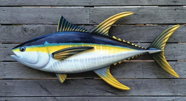 Gold Coast-based Mick Molnar has combined his love of fishing with his unique skills of sculpting timber fish.