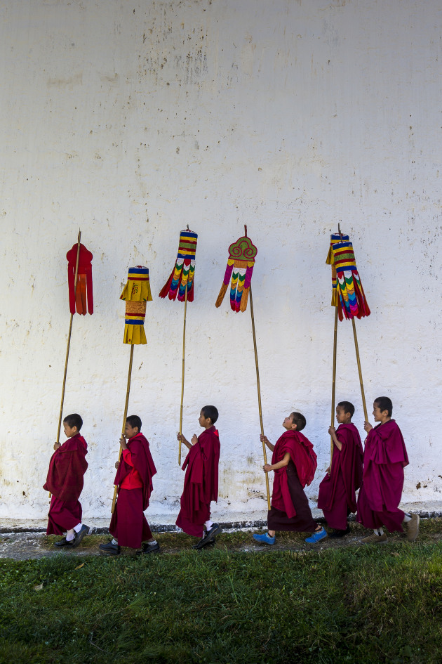 Prakhar Tshechu, Chumme Valley, Bhutan I've been to a lot of monastery festivals in the Himalaya and have learned a little bit about what to expect. However, every festival seems to also have its own unique rituals. At the Prakhar Tshechu it was these novices in procession around one of the monastery buildings. Fortunately, they walked around the building three times (which is something I have learnt to expect). Consequently, I composed the shot and waited for the monks to walk into frame – three times. Take advantage of repetitious actions to fine tune your composition and the increased chance of capturing a fleeting moment, such as a novice monk looking up to check his banner. Canon 1D X, Canon 16-35mm lens @ 24mm, 1/160 @ f8, ISO 400.