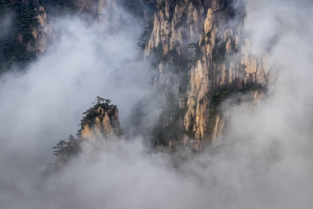Huangshan mountains, China. There is no rest at places like this, you have to be out for sunrise and sunset as atmospheric conditions can change quickly at any time. This was taken mid-afternoon, when I was out doing a recce for the evening shoot. Canon 1D X MkII, Canon 70-200mm lens @ 200mm, 1/250 @ f9, ISO 200.