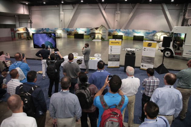 Drone delivers parcel as Pack Expo visitors watch the live demo.