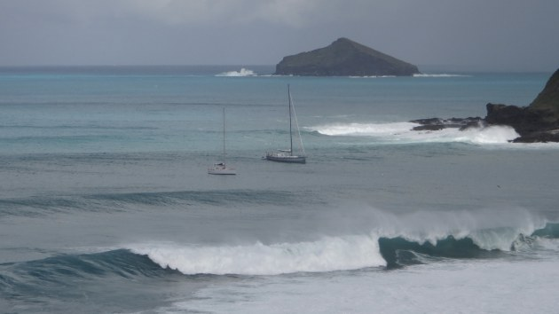A huge ocean swell was rolling in, the boats looked like they were about to take off down the face of the wave.