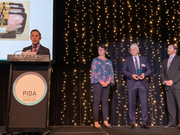 MC Anthony Peyton reads the citation for the gold award winner in the PIDA 2019 Save Food Packaging Design award, which went to Hazeldene's Chicken Farm & Sealed Air for Cryovac Darfresh on Tray vacuum skin technology.
