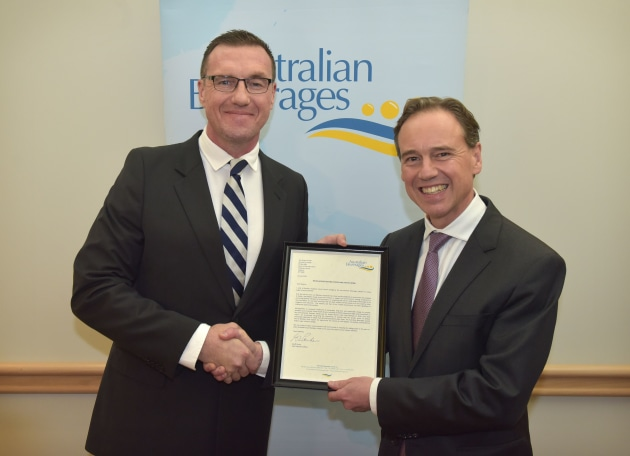 Geoff Parker with Greg Hunt, Australia's Federal Health Minister, at the signing of the industry's sugar reduction pledge in June 2018 in Canberra.
