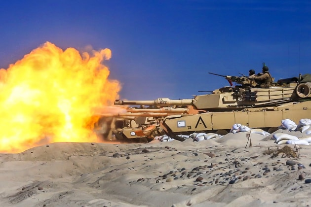 Marine Corps M1A1 Abrams tanks engage targets during live-fire training as part of Exercise Baltic Operations 2018 at Ustka, Poland. (Staff Sgt. Dengrier M. Baez)