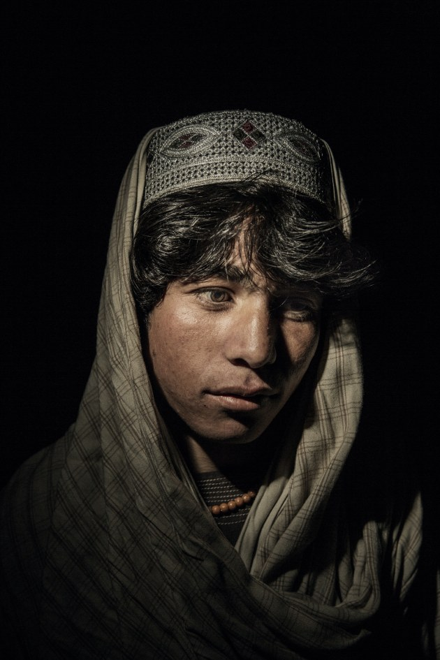 © Adam Ferguson. Dawar Khan, age 17 and an internally displaced person from Sangin District, Helmand Province, stands for a portrait at a camp for IDP in Kabul, Afghanistan.
