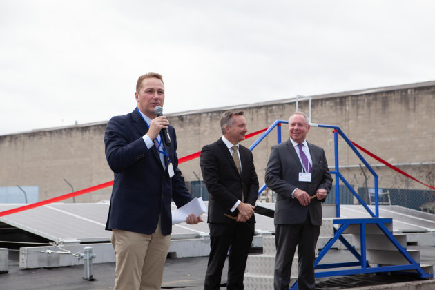 Aleks Lajovic, MD of Impact International, speaking at the solar farm launch. To his right, the Hon Chris Bowen MP and the Hon Dr. Hugh McDermott MP look on.  Image:  Smart Commercial Solar