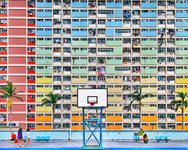 "IG: @justphotons. Alex Jiang (US), iPhone XS Max. Chen Man says: ""This is a photo filled with lovely colour and sense of story in the composition. Zooming in, you can see details of each family and their unique touch. The basketball hoop is placed right in the middle of the photo, adding more stories behind the image."" Annet de Graaf says: ""The narrative in architecture. There is actually life behind the surface of an average apartment building in an unknown city. Vivid colours and a perfect composition with the basketball board right in the middle! Great eye."""