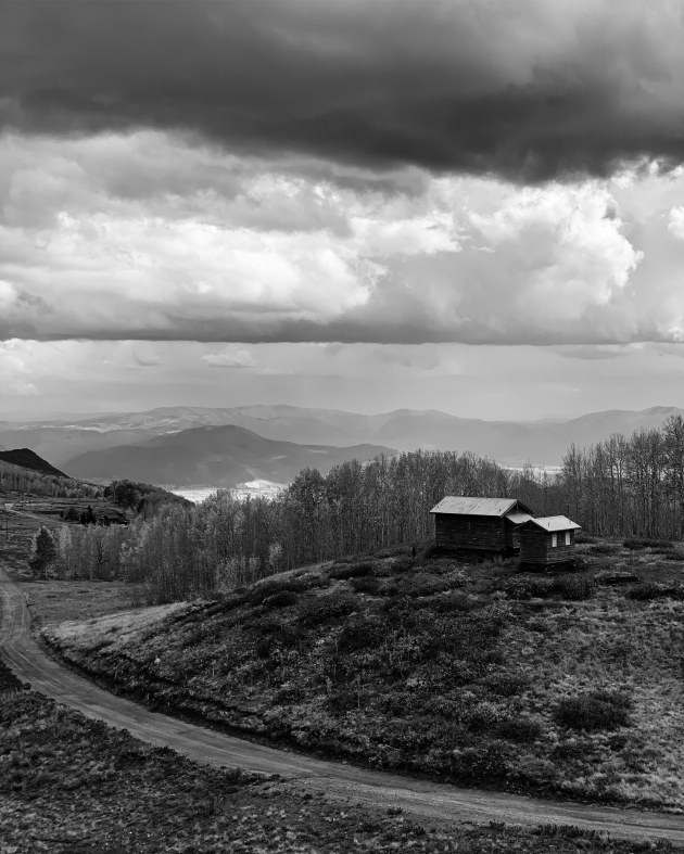 "IG: @bernardantolin. Bernard Antolin (US), iPhone XS Max. Kaiann Drance says: ""Looks like a simple scene but a good choice of using black and white to elevate it with a different mood. Helps to bring out the dramatic contrast in the clouds and the surrounding landscape."""