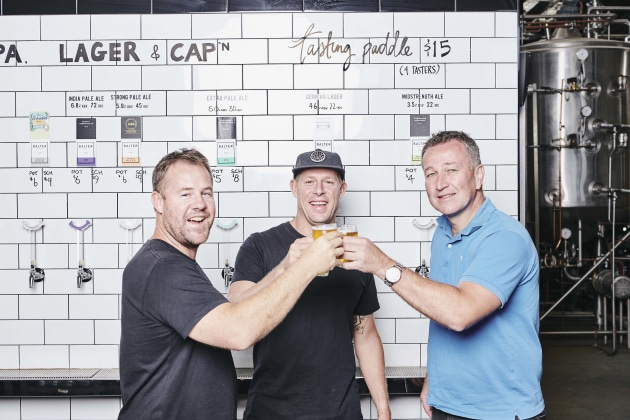 Balter CEO and co-founder Ant Macdonald, co-founder Mick Fanning and CUB CEO Peter Filipovic