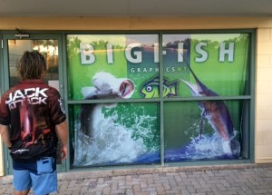Jack Harnwell, resplendent in his Jack Attack shirt, checks out the entrance to the Big Fish Graphics factory in Darwin.