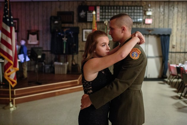 © Sarah Blesener. Garett, a senior member of the Young Marines, dances with his girlfriend at a Young Marines ball, 21 October 2017, Hanover, Pennsylvania. The Young Marines are a non-profit program in the United States that teach patriotic education, drug awareness education, and basic military introductions to students across the country.