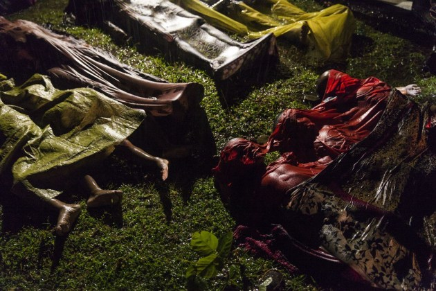 Rohingya Crisis. World Press Photo of the Year Nominee. © Patrick Brown.  The bodies of Rohingya refugees are laid out after the boat in which they were attempting to flee Myanmar capsized about eight kilometers off Inani Beach, near Cox's Bazar, Bangladesh. Around 100 people were on the boat before it capsized. There were 17 survivors. The Rohingya are a predominantly Muslim minority group in Rakhine State, western Myanmar. They number around one million people, but laws passed in the 1980s effectively deprived them of Myanmar citizenship. Violence erupted in Myanmar on 25 August after a faction of Rohingya militants attacked police posts, killing 12 members of the Myanmar security forces. Myanmar authorities, in places supported by groups of Buddhists, launched a crackdown, attacking Rohingya villages and burning houses.  Commissioned by Panos Pictures, for UNICEF.