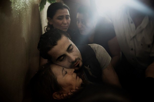 A small village mourns the loss of a son, killed in an ambush at the other end of the country. the lieutenant was the first soldier to fall from his village of 125 people. Latakia, Syria. © Andrea Bruce (NOOR).