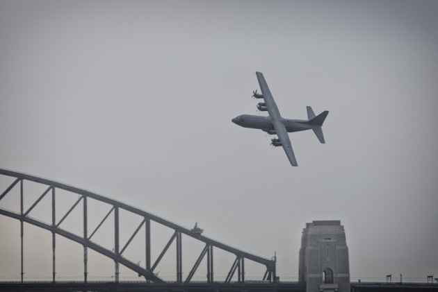 A RAAF C-130J Hercules conducts a handling display over Sydney Harbour.