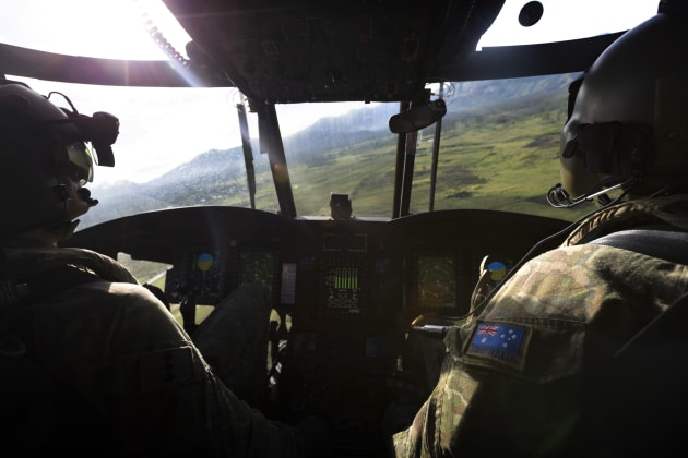 Army pilots Captain Frazer Watson (left) and Captain Steven Deyes fly a CH-47F Chinook helicopter towards Moro Airport.