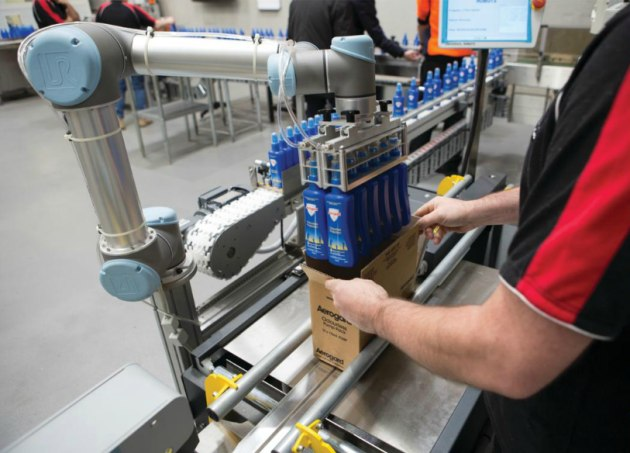 Cobots used to place bottles in cases and cases on pallets. (Image: Andrew Donald Design Engineering)
