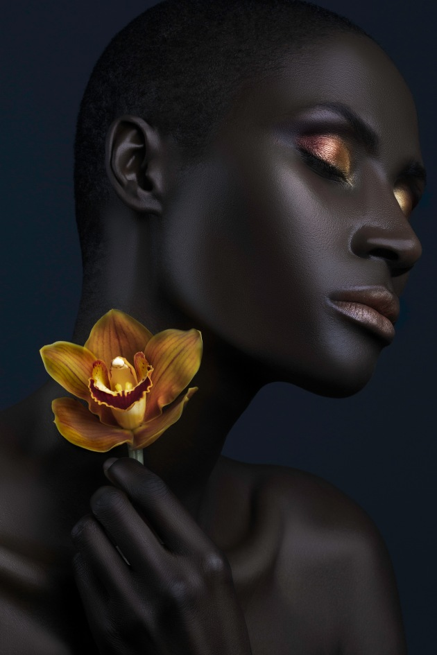 "© Lindsay Adler. ""I wanted the model's skin to mimic the smooth texture of the flower petals. It was lit with a single soft light source (right) and a silver reflector (left) to illuminate her jawline."""