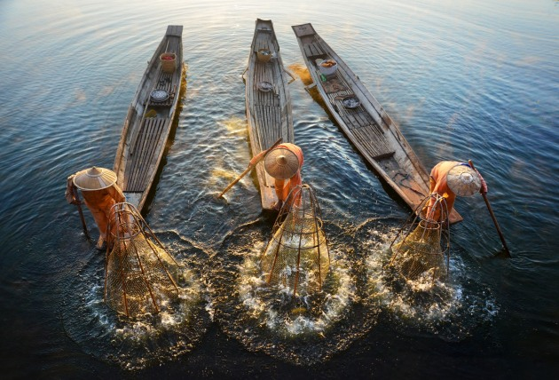 Fishermen on Inle Lake, Myanmar, shot from a bridge © David Lazar