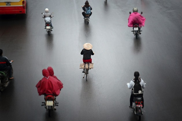 Commuters on the streets of Hanoi, Vietnam.