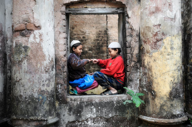 Kids playing among a temple ruin, Bangladesh