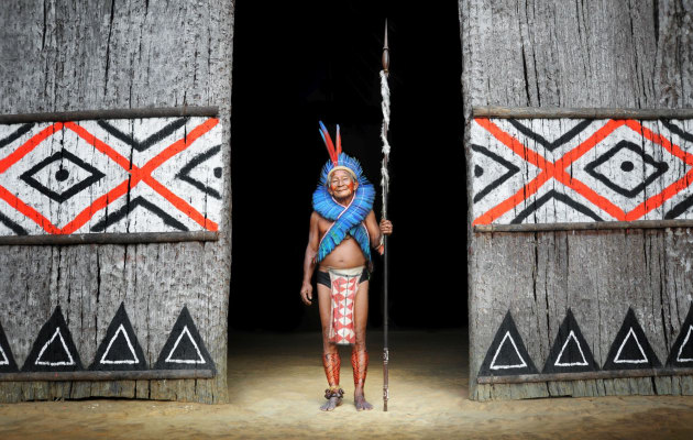 Amazonian village chief in the doorway to his hut, Brazil