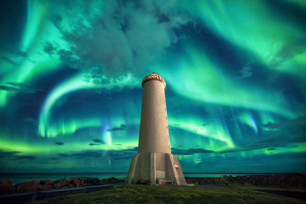 Akranes, Iceland. Forecast was a Kp6 but what we got was a Kp7. This is one of the greatest displays we've ever seen. We aligned the lighthouse in the centre of the frame and allowed the dancing ribbons of green to fill the frame behind. Nikon D810, 14-24mm f2.8 lens. 2.5S @ F2.8, ISO 4000.