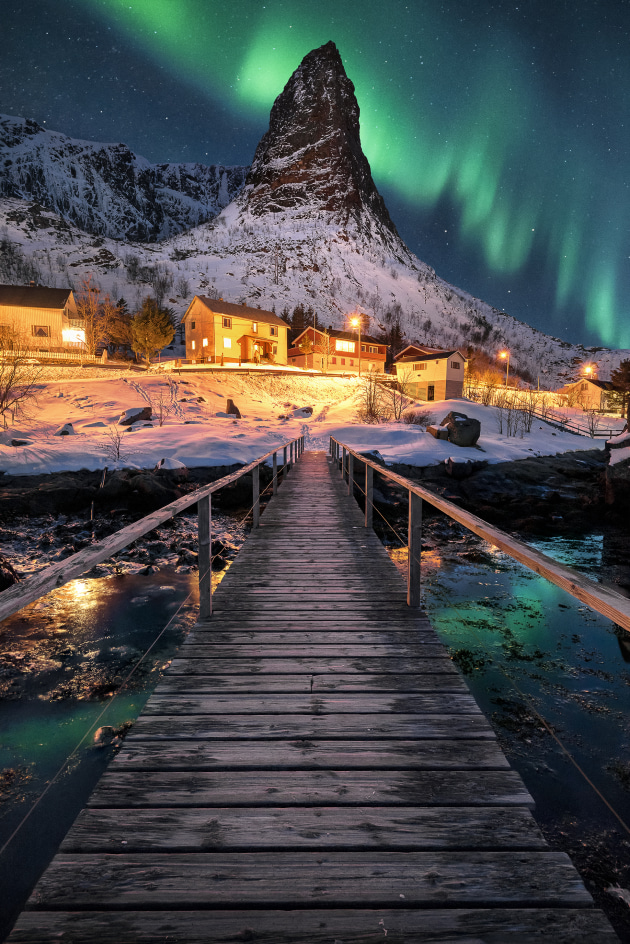 Lofoten, Norway. When it comes to leading lines this pedestrian bridge perfectly leads the your eye into the frame towards the snowy peak. With compositions as strong as this you don't need a great display of aurora to make an image pop. Nikon D810, 16-35mm f4 lens. 25s @ f9, ISO 1600, +0.67 EV