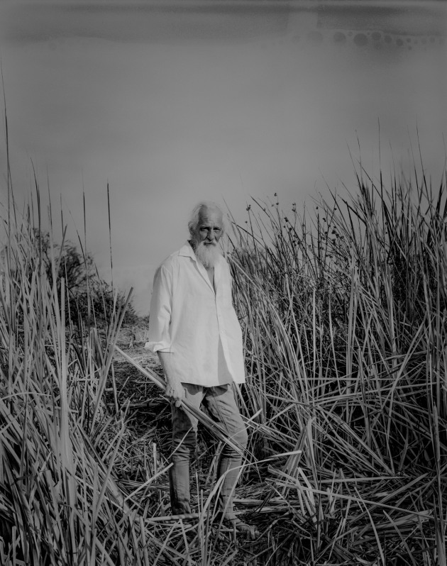 "© Christopher Ireland. Dry Swamp, dreaming... Greg Ireland stands in a parched swamp on the Hay Plain. ""Bubbles left on the 4x5 emulsion after processing allude to the crystallised memory of a flourishing wetland."""