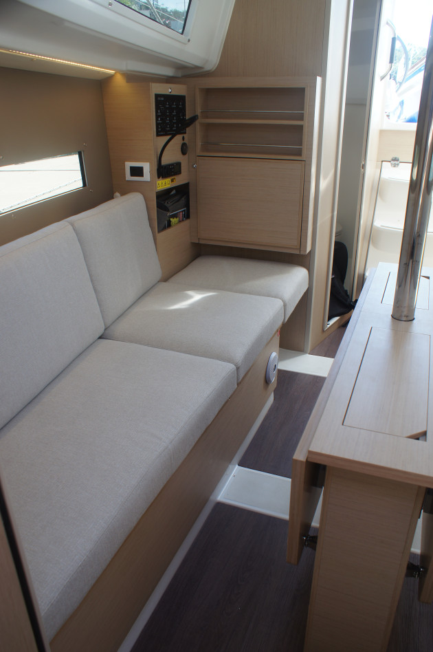 The starboard settee with nav seat in place.