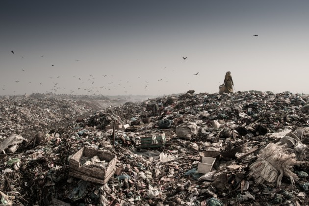"""The most suffocating and infested environment I have ever shot in – a city rubbish tip just outside of Sylhet, Bangladesh."" © Simon Lister."