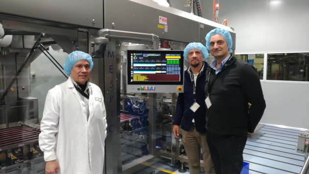 FreshFoods factory manager Ramon Alvarez, Mespic owner Fabio Garavini, and Esko technical sales manager Paul Asciak in the newly automated factory.