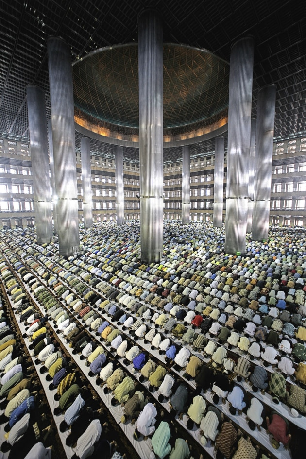 © Ahmad Zamroni. Muslims at prayer, Jakarta. More than 90 percent of Indonesia's some 220 million people follow Islam, making it the worlds biggest Muslim nation. 2007, from the Untitled series 2007, pigment inkjet print, 139 x 64 x 5.5 cm.