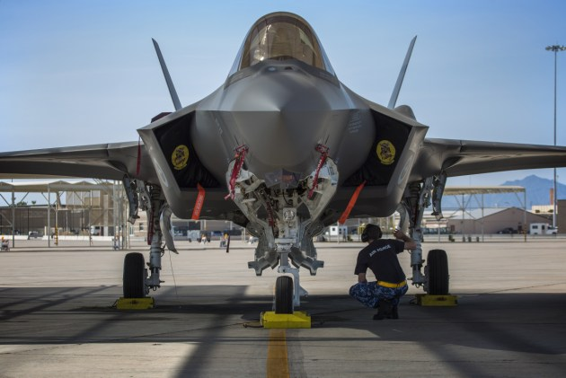 Royal Australian Air Force maintainer, Corporal Cory Cochrane, inspects an Australian F-35A on the flight line at Luke Air Force Base, Arizona, USA. Defence