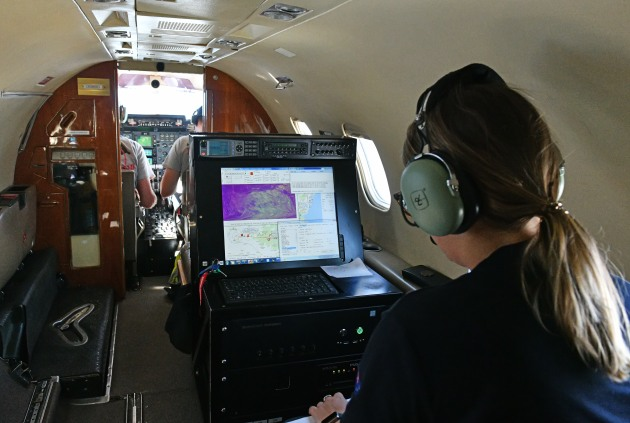 A Firescan operator inside one of the Learjets during a mission.