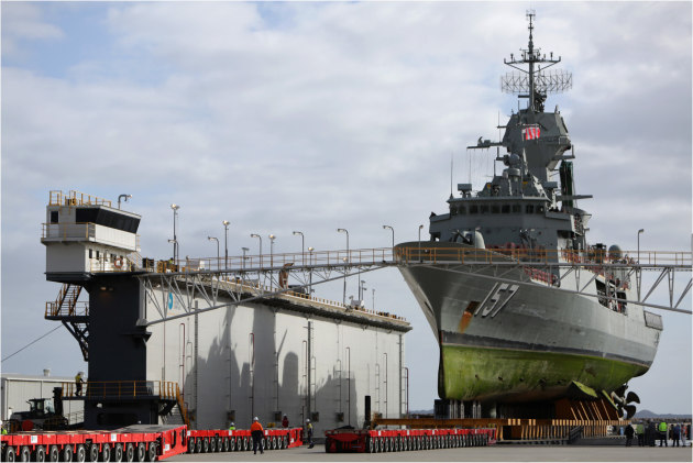 HMAS Perth is readied for its move out of the floating dock onto the hard stand at the Australian Marine Complex Common User Facility at Henderson.