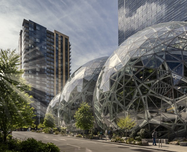 © Tim Griffith. Located in downtown Seattle and designed by architects NBBJ, the Amazon Domes provide inspiration in a real-time test environment for the future of the workplace.