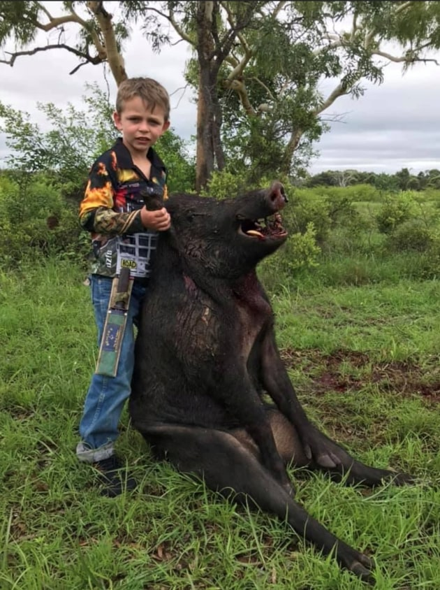 Awesome young Bloke With Boar