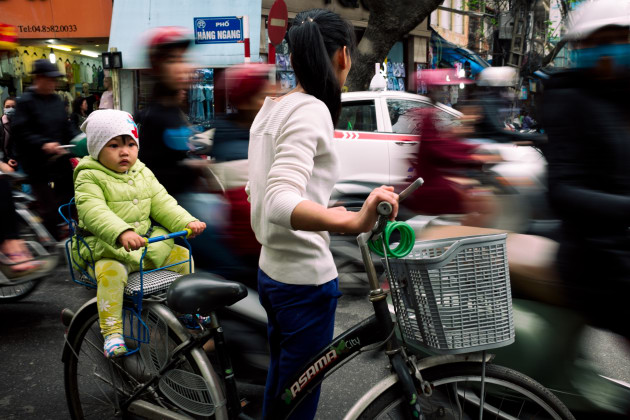 Busy intersection in Hanoi, Vietnam. By using my Fujifilm X100S, I was able to blend into the crowd without being noticed. I shot this from waist level using single point autofocus on the child. Fuji X100S, fixed 35mm f2 @ 35mm, 1/15s @ f7, 200 ISO. Curves, contrast and clarity adjusted in Adobe Lightroom CC.