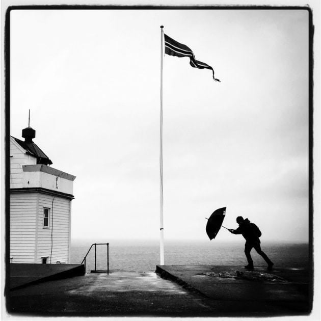 "HONOURABLE MENTION - Douwe Dijkstra - Nordic Saga ""Braving the elements at Ryvarden Lighthouse, Norway."""