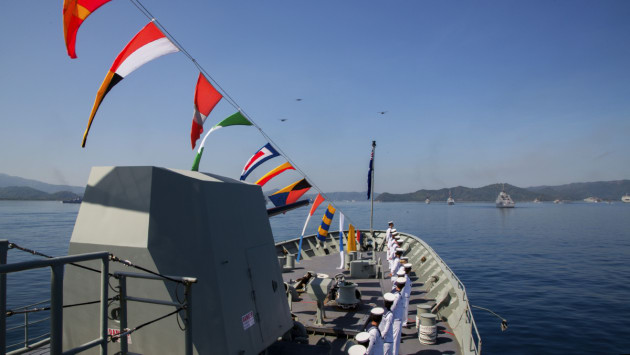 HMAS Anzac sailors line the decks for fleet inspection at Lombok, Indonesia.