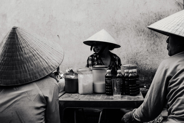 Three women chatting at a local market in Hoi An, Vietnam. Using the Fujifilm X100S helped me stay unnoticed with a camera and the EVF made framing and composing as simple as watching it in real time. Fujifilm X100S, fixed 35mm f/2 @ 35mm, 1/125s @ f8, 200 ISO, handheld. Monochrome in-camera filter, levels and contrast adjustment in Adobe Photoshop CC.